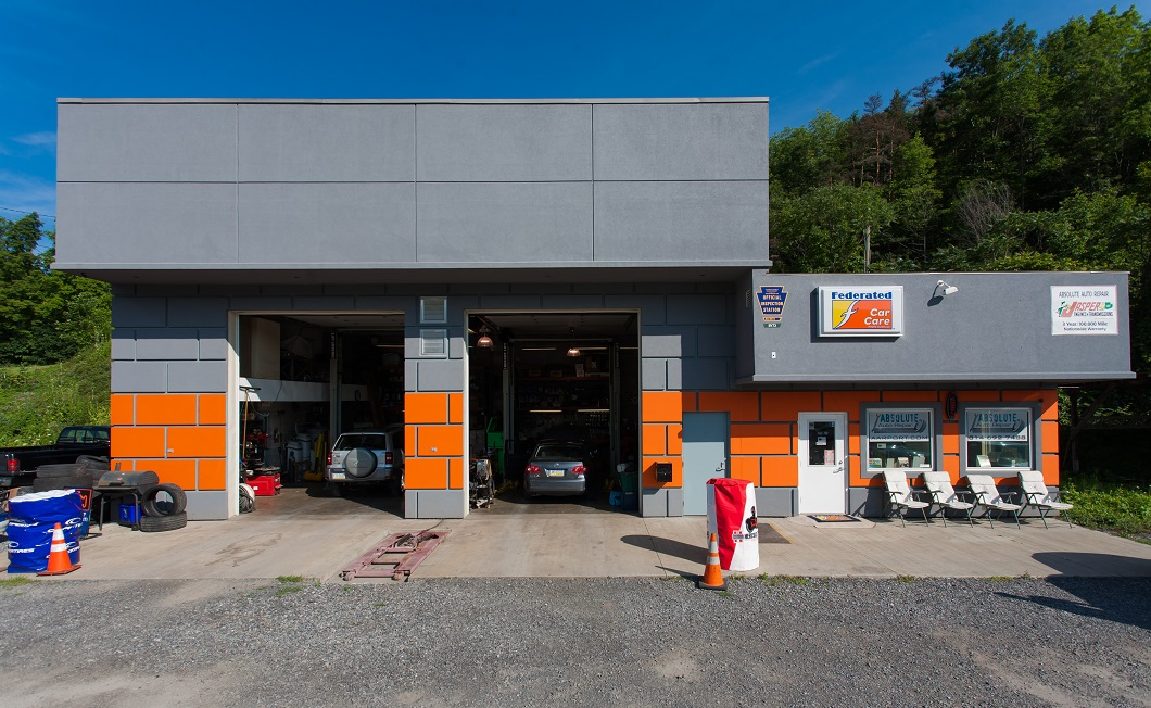 Two bay shop, no sign, modern facility inspection station.  professional auto repair, European auto repair, inspection station, mechanic, hones mechanic, professional mechanic, modern facility