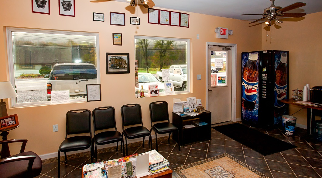 Waiting area, clean comfortable, free wifi, free coffee professional auto repair shop